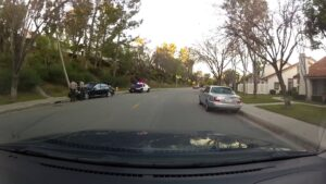 Mercedes crashed into utility pole, video still from dashcam.