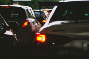 close up of tail lights of cars sitting in traffic